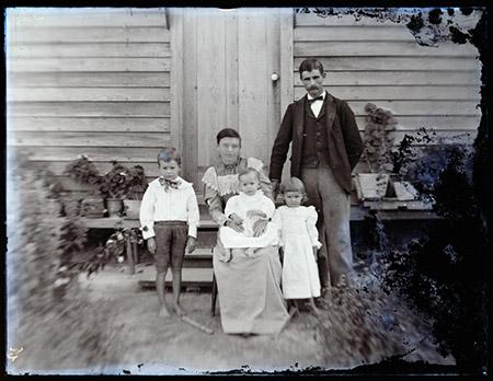 family portrait taken in front of doorway.