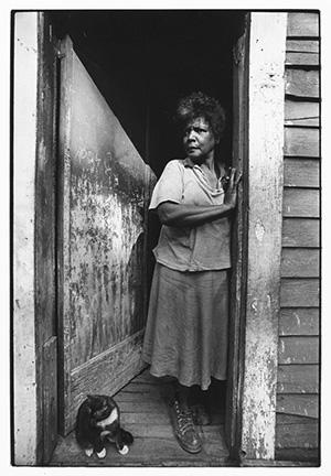 Woman with cat in doorway