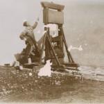 Man operating a guillotine at Tsingtao (Qingdao), China