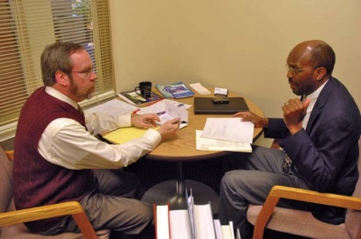 Smith confers with Associate University Counsel Henry Cuthbert.