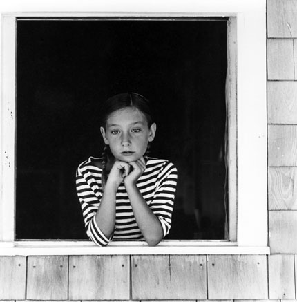 Olive Pierce: Girl in window, Vinalhaven, Maine, 1964