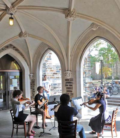 String quartet performing outside entrance to Perkins Library
