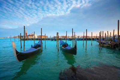 Two gondolas in the water in Venice