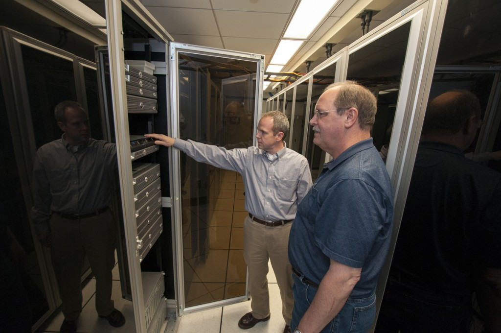 Server Closet, Perkins Library: Brad Williams (left), Head of Core Services, and Erick Larson, Senior System Administrator, check on the servers that power the Libraries' rapidly expanding digital infrastructure.