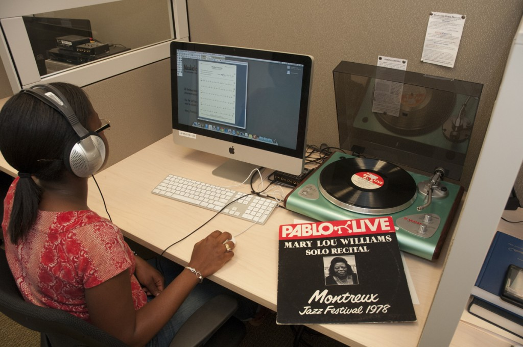 Music Library: Old technology meets new. A student listens to a 1978 recording on vinyl and works on rhythm exercises on an iMac.