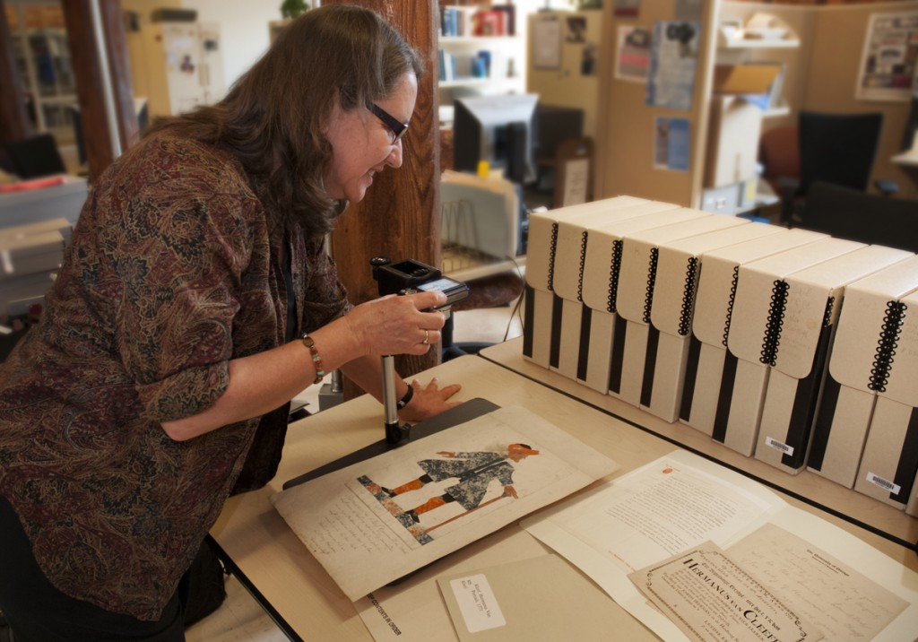 Smith Warehouse, Rubenstein Library Technical Services: Paula Mangiafico, Senior Processing Archivist in Rubenstein Library Technical Services, photographs an eighteenth-century paper doll self-portrait by Hermanus van Kleef, a Dutchman who died in 1775 at the age of 104. The item was an unexpected find while Mangiafico was processing materials in the History of Medicine Collections. Such curious discoveries are one of the daily joys of being an archivist.