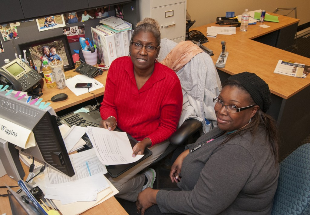 Library Administration Office: Administrative Office Staff Assistant Lynell Wiggins (left) and Jameca Dupree, Financial Analyst in the Business Office, track recent travel and business expenses and keep an eye on the Libraries' budget.