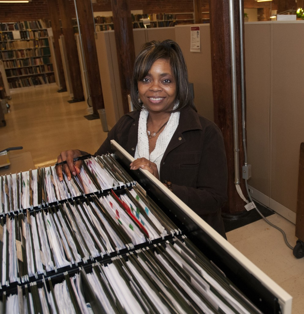 Smith Warehouse: Shelia Webb, Accounting Invoice Specialist in Acquisitions, shows what $16 million in invoices looks like. That's approximately how much the Libraries spend each year to purchase collection materials. The money comes from university-allocated funds, endowments, grants, and gifts.