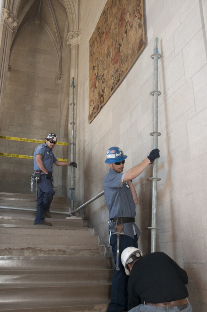 Rubenstein Library: Workers set up scaffolding to remove a tapestry in the tower staircase of the Rubenstein Library. The tapestry is being removed in preparation for the upcoming library renovation. It has been on loan to the Libraries since 1986 from the Nasher Museum and will return to its proper home.