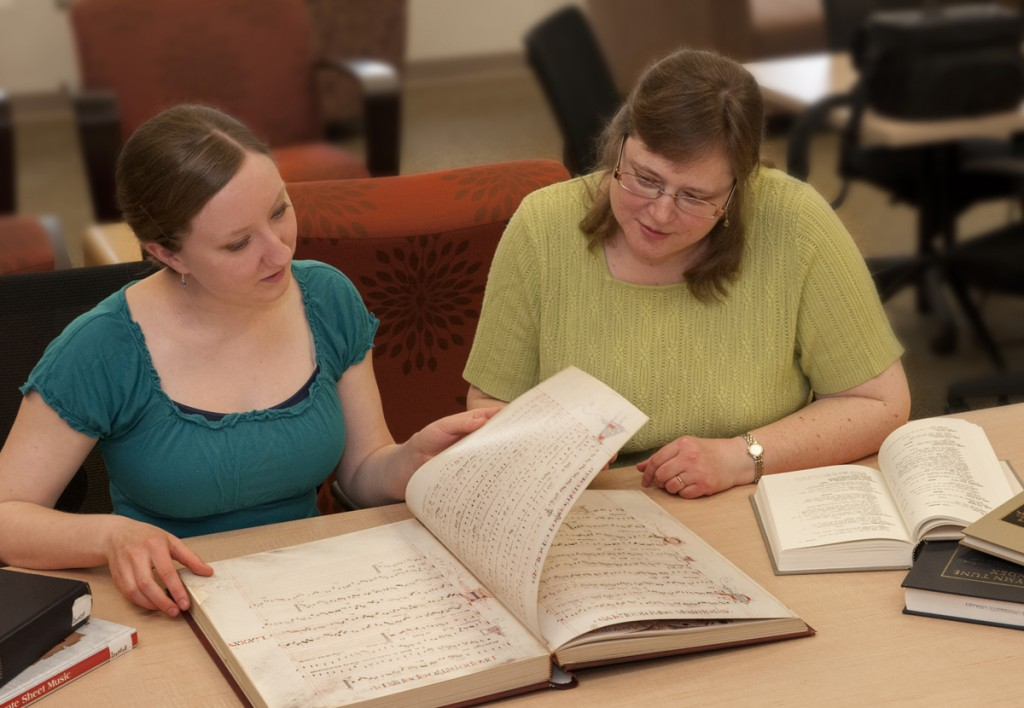 Music Library: Music Librarian Laura Williams (right) and musicology Ph.D. candidate Samantha Arten examine a recently acquired facsimile of the Squarcialupi Codex (c. 1410), a lavishly illuminated manuscript of fourteenth-century Italian music.