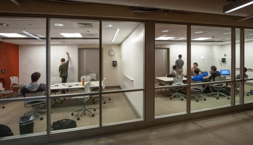 The Link: At night, Perkins and Bostock Libraries come alive. Students make use of white board walls in the Link as they work on end-of-the-semester projects and prepare for final exams.