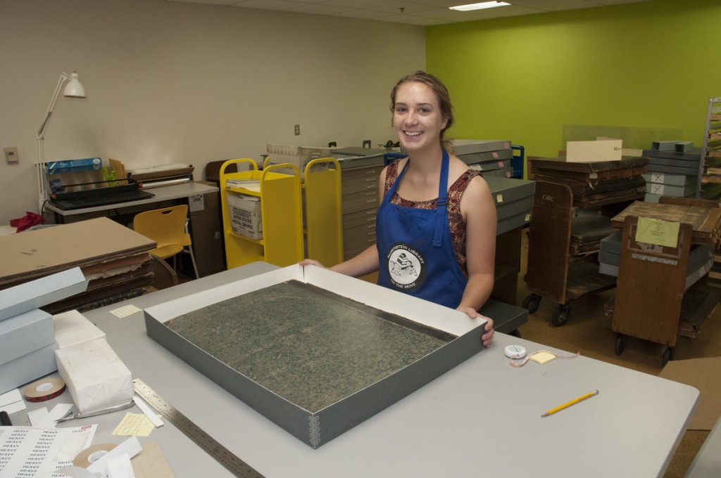 Verne and Tanya Roberts Conservation Lab: Senior psychology major and work-study student Kaiti Dunlap builds custom enclosures for the Rubenstein Library's fragile historical newspaper collection.