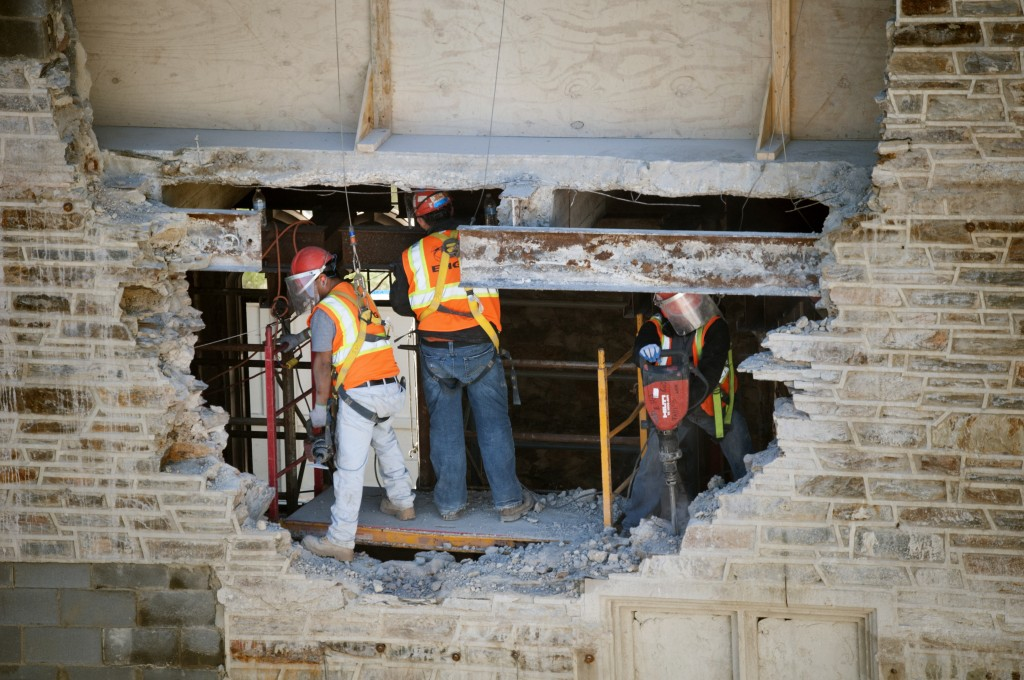 December 2013: Demolishing a portion of the original stone wall. As some floors of the library get reconfigured, new openings have to be created to accommodate new hallways and entrances.