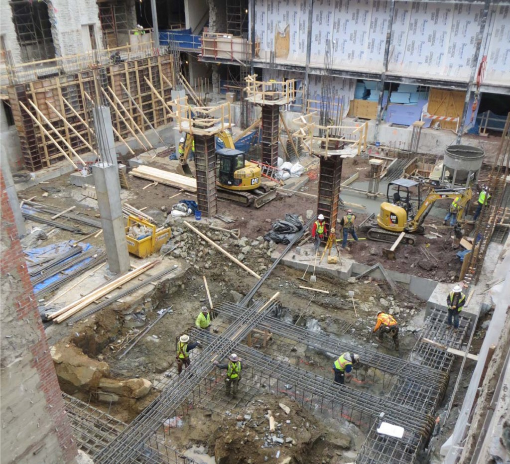 February 2014: With the new foundation in place, new columns and column footings are being built to support the new stack core.