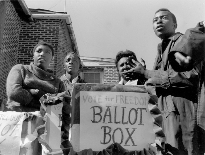 SNCC organizers set up polling station in Greenwood, Mississippi, for the 1963 Freedom Vote election. © 1976 Matt Herron/Take Stock