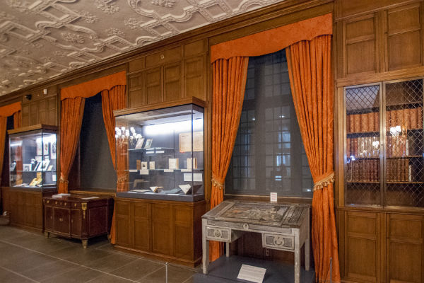 "The Mary Duke Biddle Room was originally designed to resemble a ""gentleman's library."" The renovation preserved the original charm and character of the room, but new exhibit cases have been installed to showcase rare and unique materials from the Rubenstein Library, including Virginia Woolf's writing desk, recently acquired as part of the Lisa Unger Baskin Collection and now on permanent display."