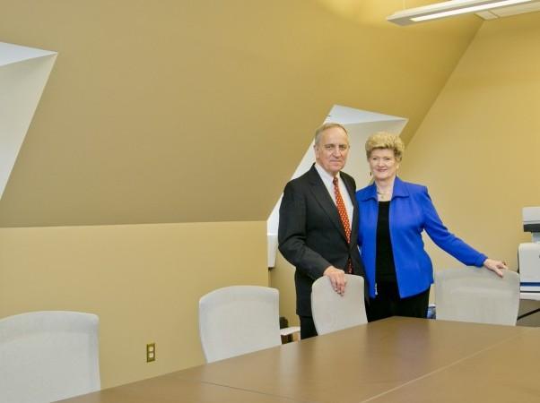 Ann and Cary Gravatt pose for a portrait in the Gravatt Seminar Room.