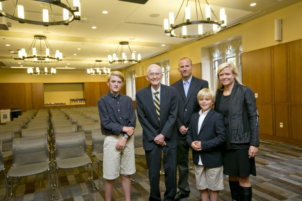The Holsti family pose for a portrait in the Holsti Anderson Assembly Room.