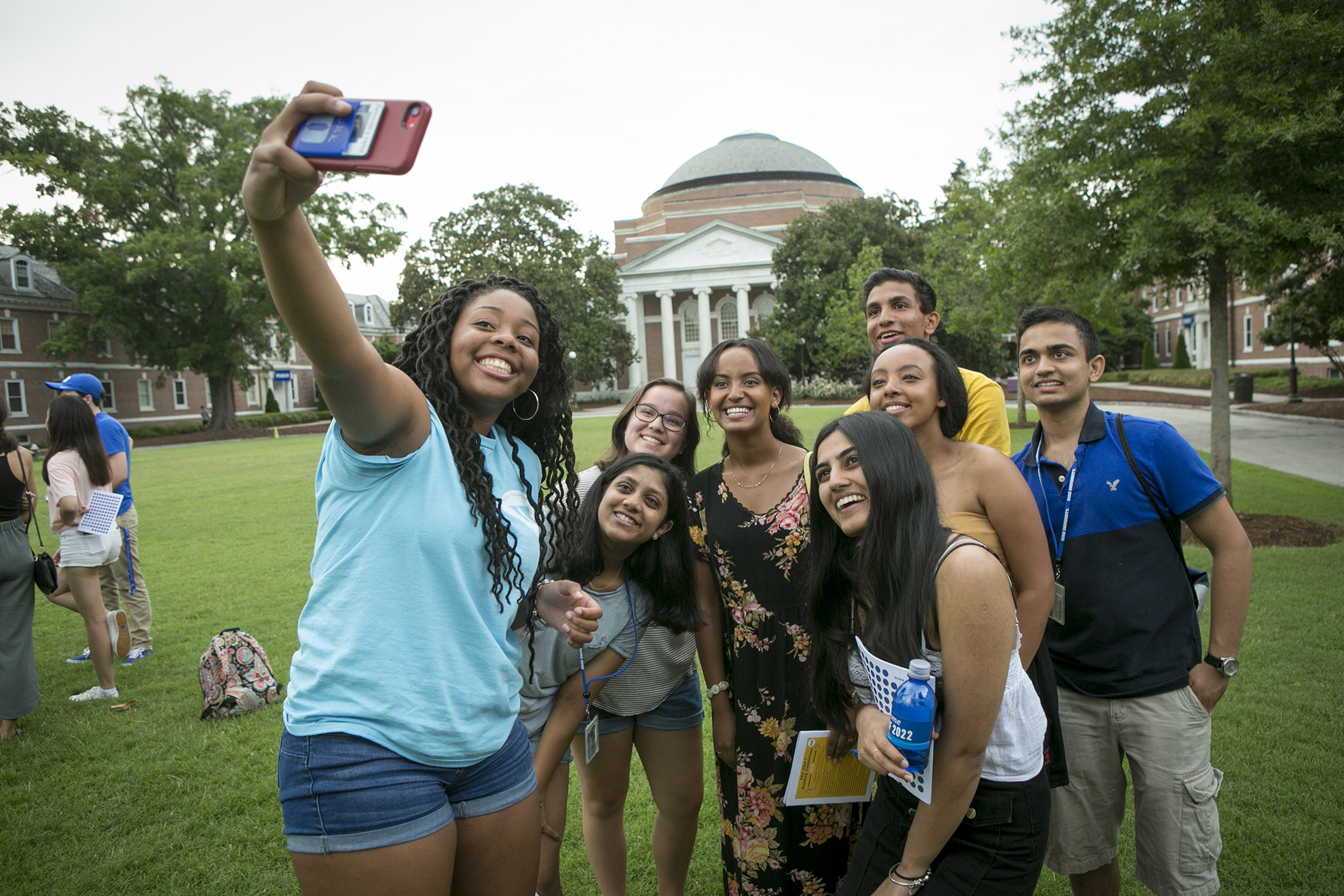 First-year students take a selfie during Orientation Week on the East Campus lawn. Photo by Jared Lazarus.