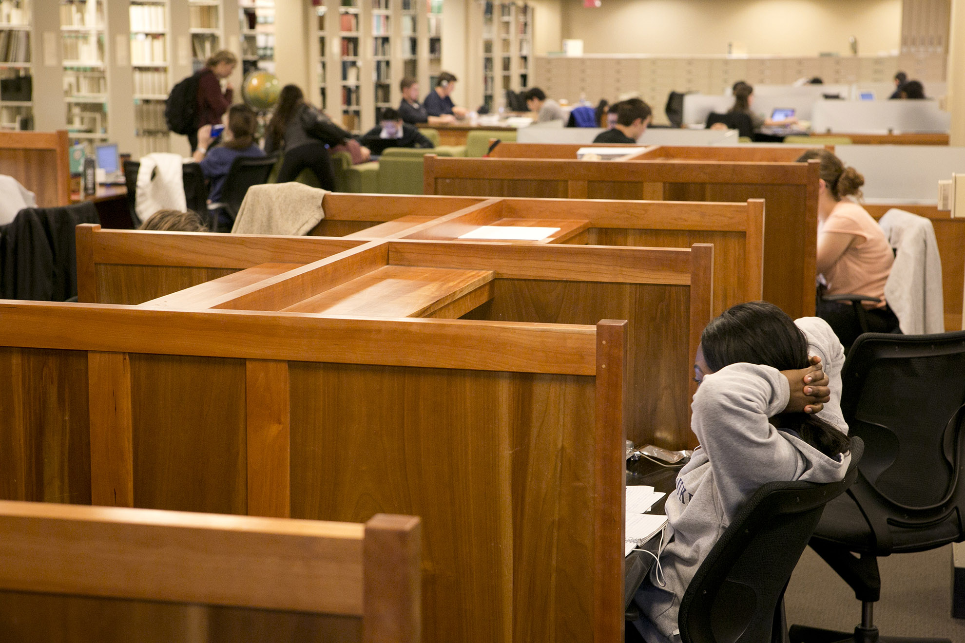 Students studying in Perkins and Bostock Libraries.