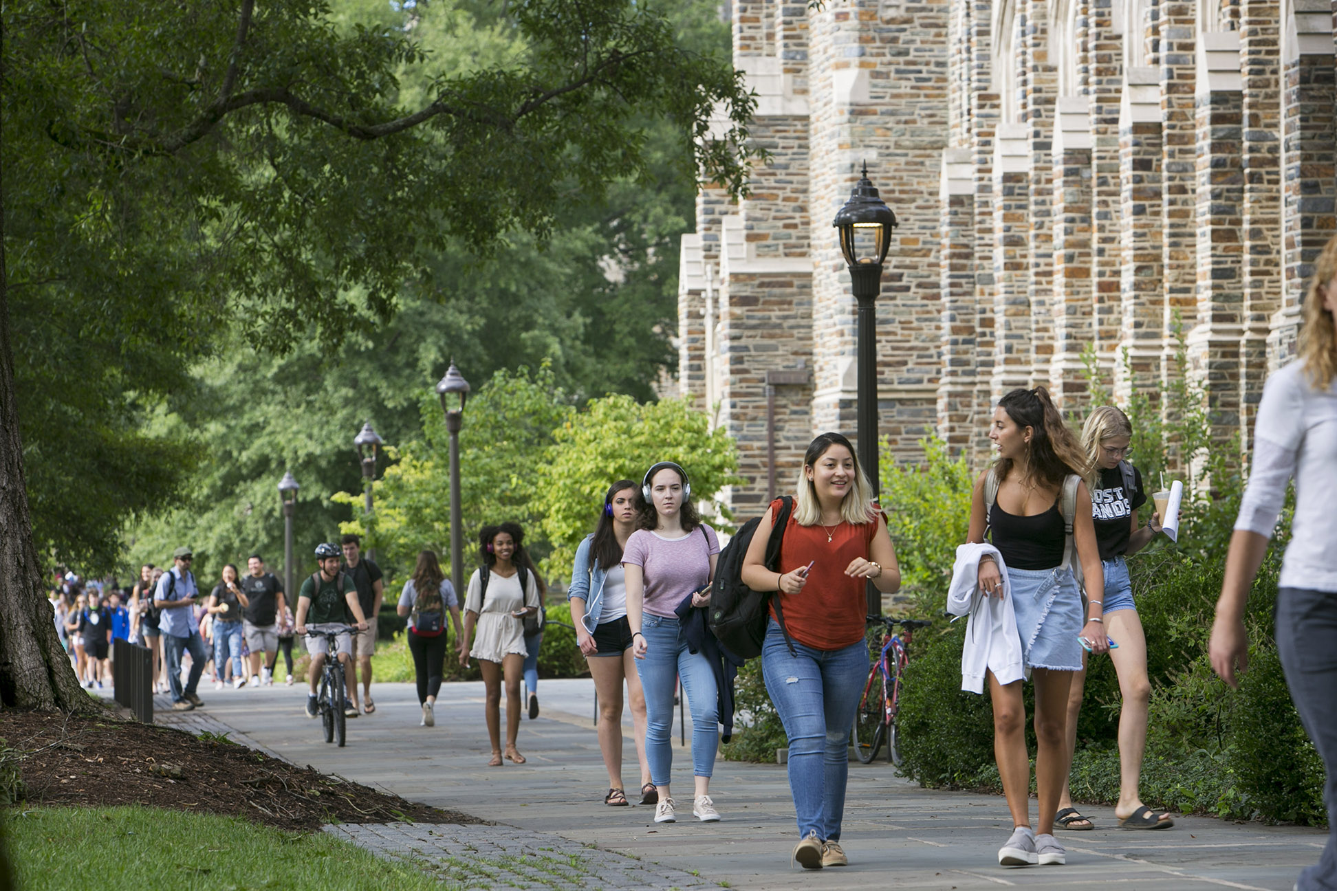 Students walk past Rubenstein Library during class change on the Abele Quad.