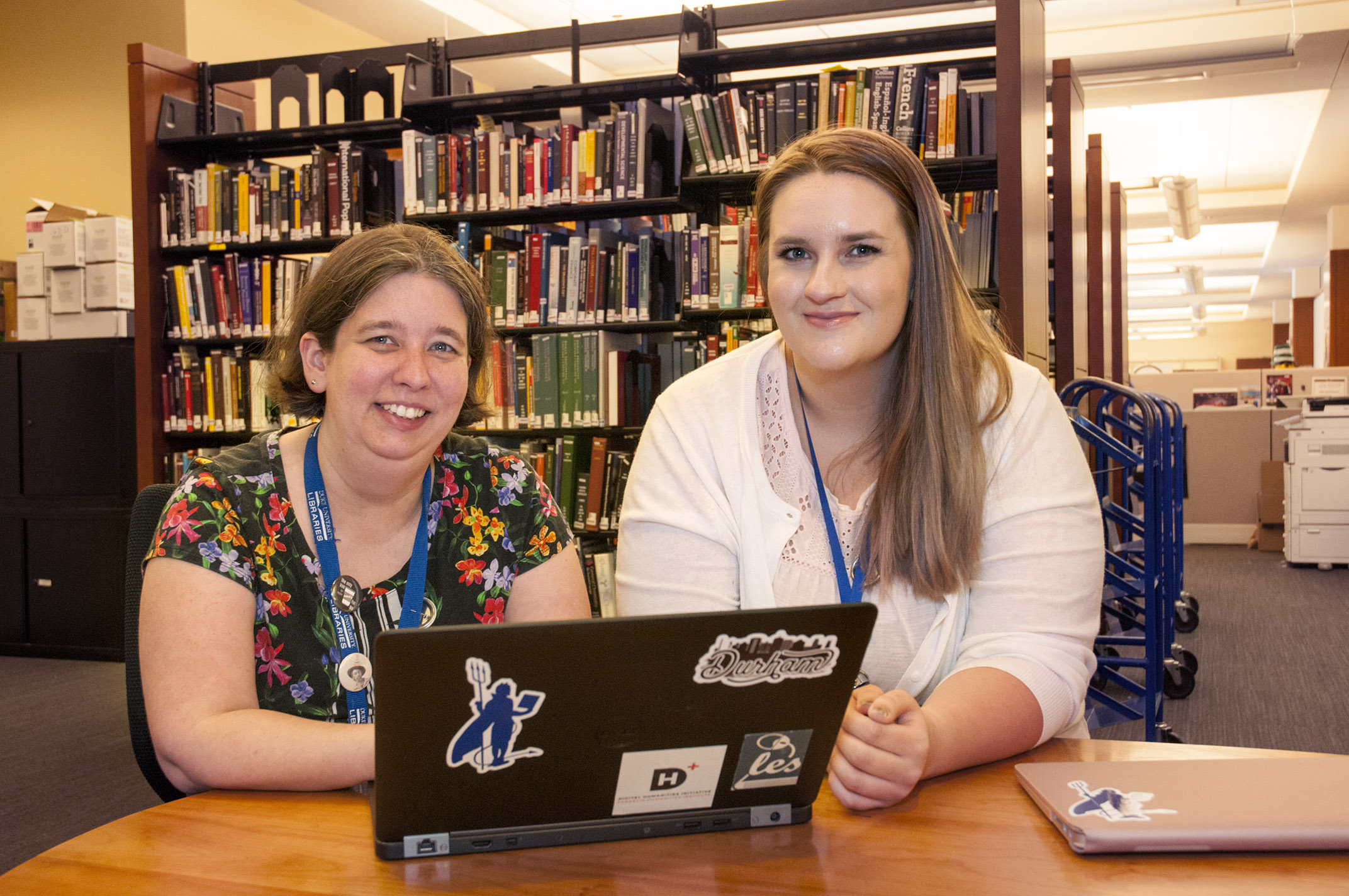 Arianne Hartsell-Gundy (left), Librarian for Literature and Theater Studies, with Student Success Intern Megan Boland.