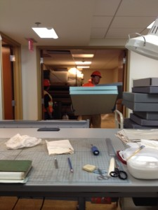 Construction crew helps remove supplies.