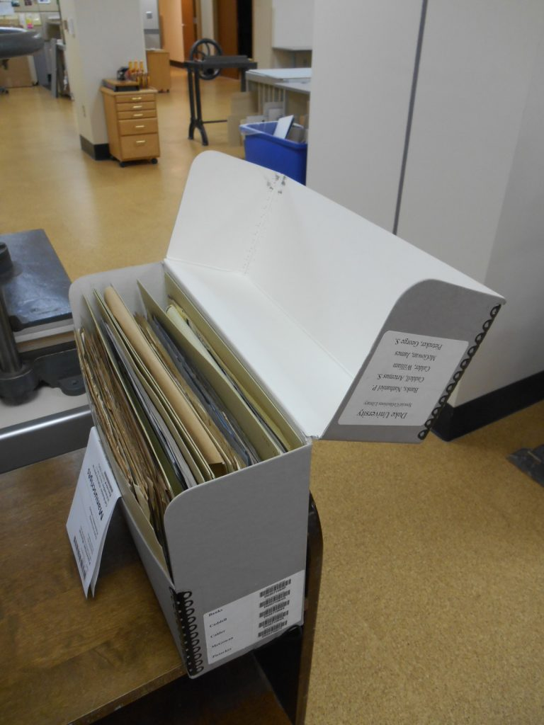 Open records box with folders inside.