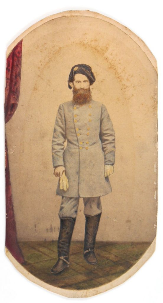 Portrait of Civil War soldier in uniform, wearing a hat.