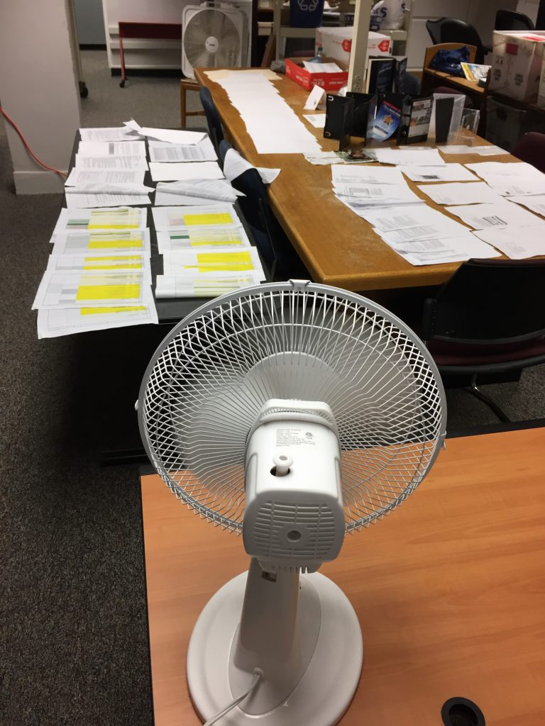 Oscillating fans drying damp papers
