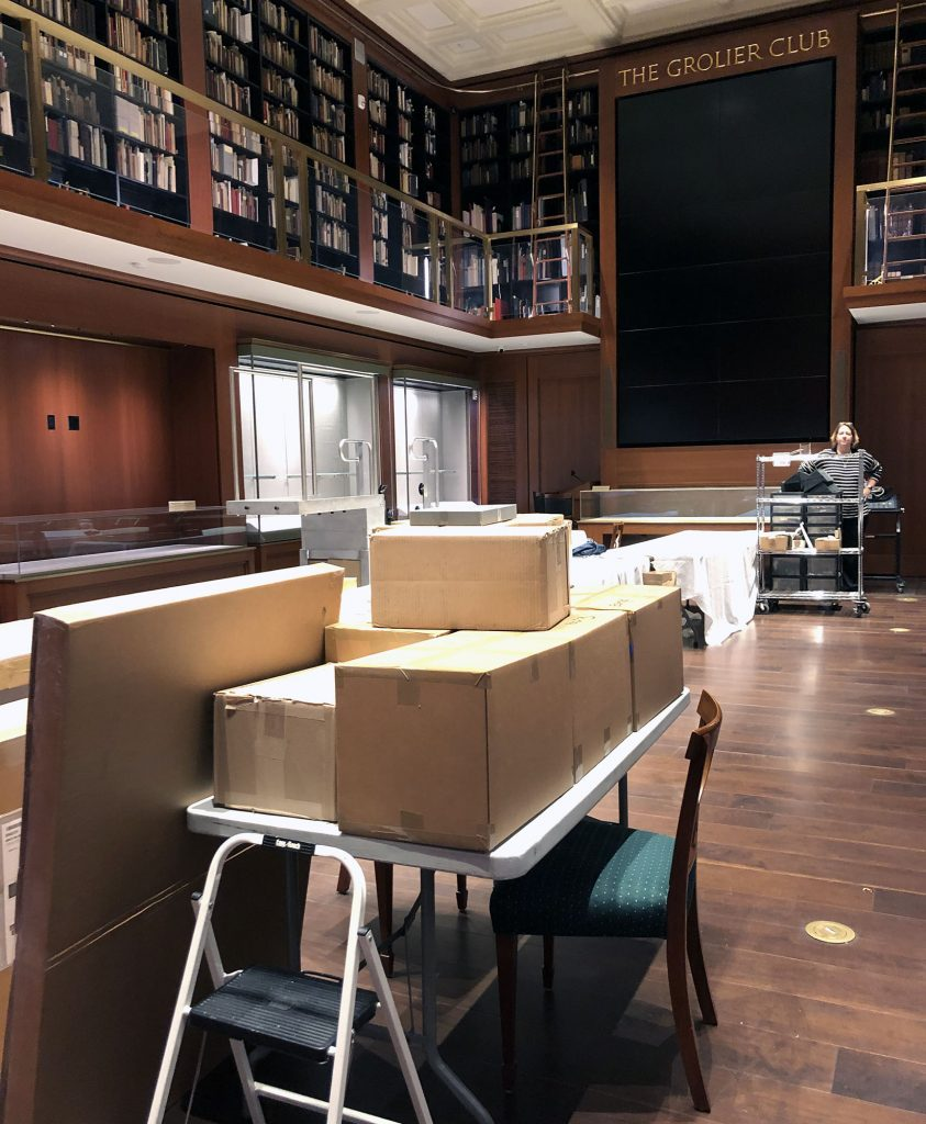 The Grolier Club exhibit space, filled with packed boxes.