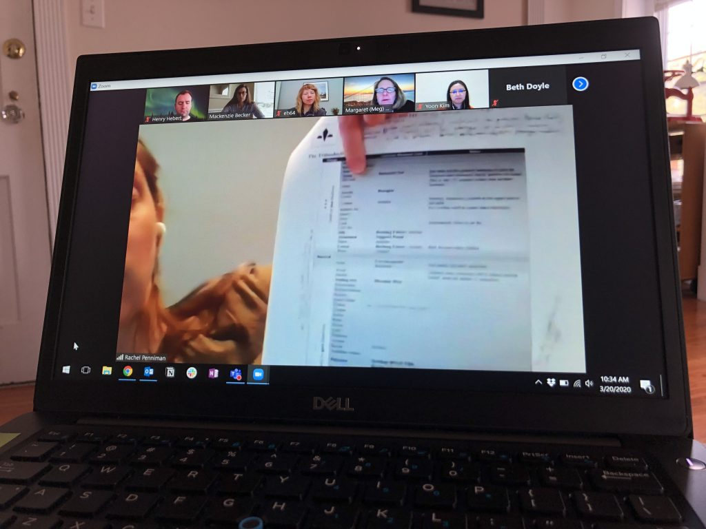 Laptop screen with Zoom meeting in progress