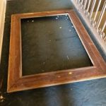 damaged frame on floor