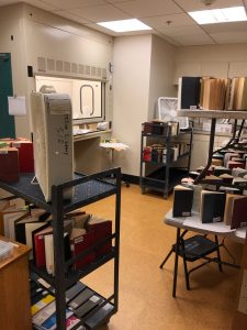 books drying in fume hood and by fans