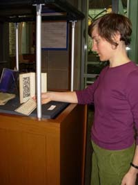 Curator Angela DiVeglia arranges exhibit materials