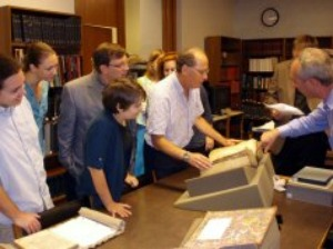 Students and faculty view the new manuscript with Curator of Collections Andy Armacost. Image courtesy Lucas Van Rompay.