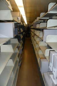 Stacks shelving cleared during a recent move