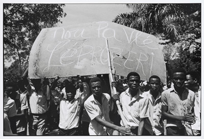 Protesters with large sign, Les Gonaïves, Haiti, 1986