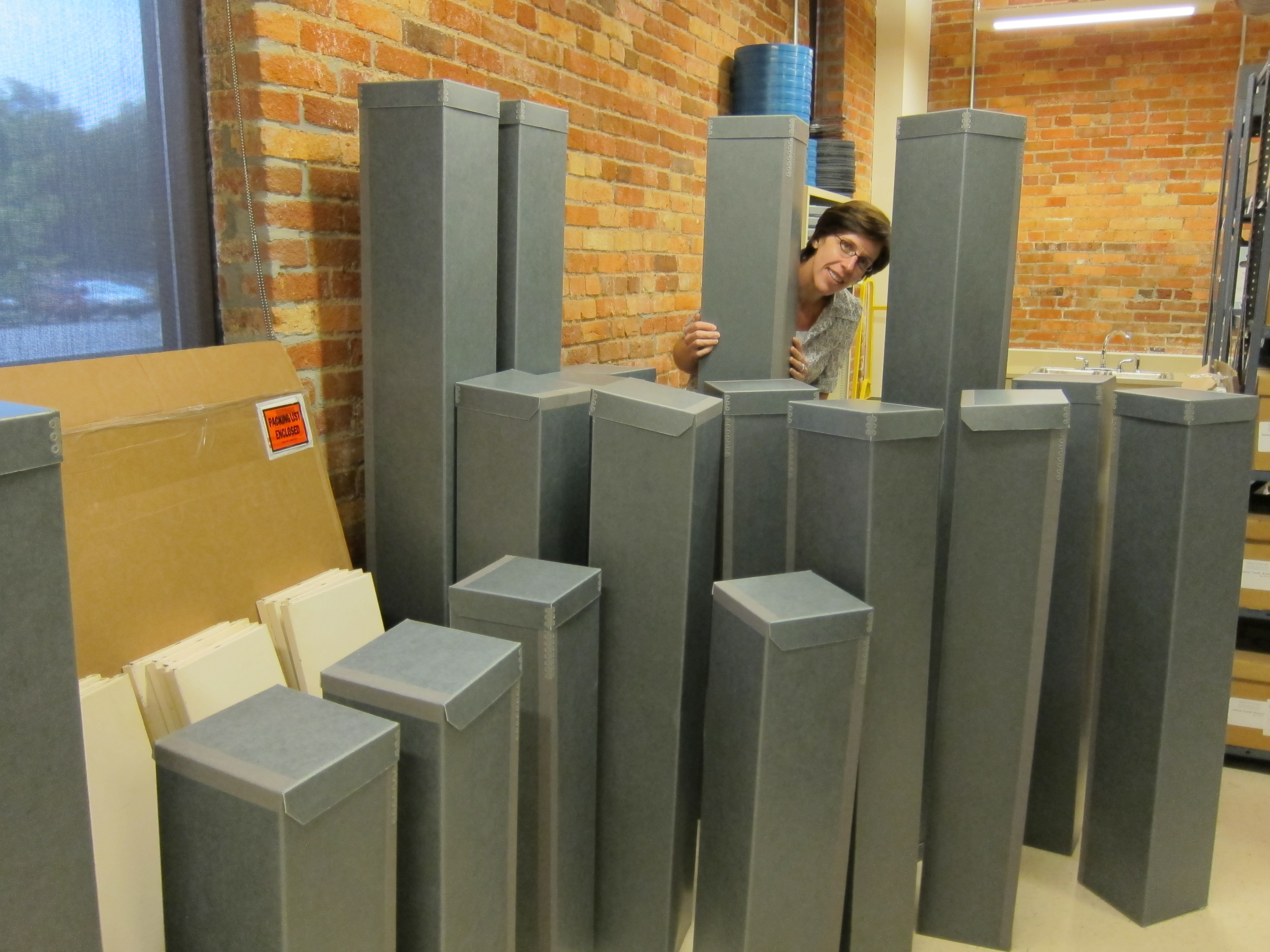 Mary Samouelian in her new forest of boxes for the Doris Duke architectural drawings.