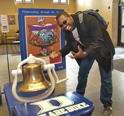 An excited student takes a turn ringing the Victory Bell.