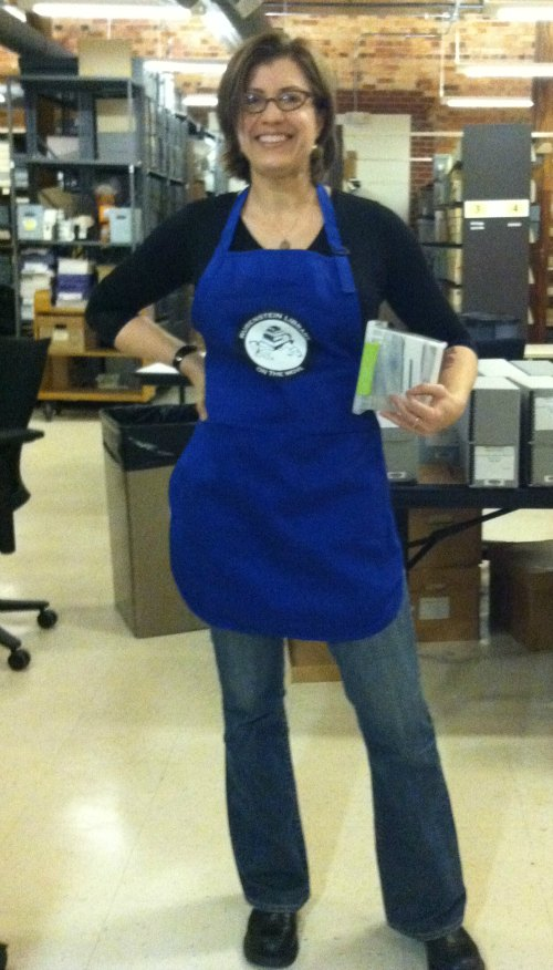 Megan Lewis, Technical Services Archivist for the Sallie Bingham Center, in the official 2013 Rubenstein Library collections move apron.