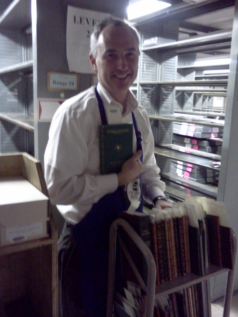 Our Curator of Collections and some bound Walt Whitman manuscripts.