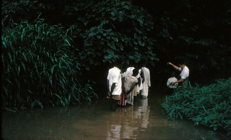 John S. McGee baptizing believers in Nigeria