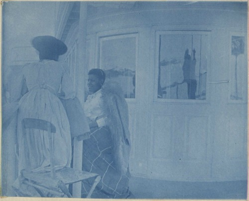African American women aboard a steamboat, from the Tidewater album, ca. 1900.