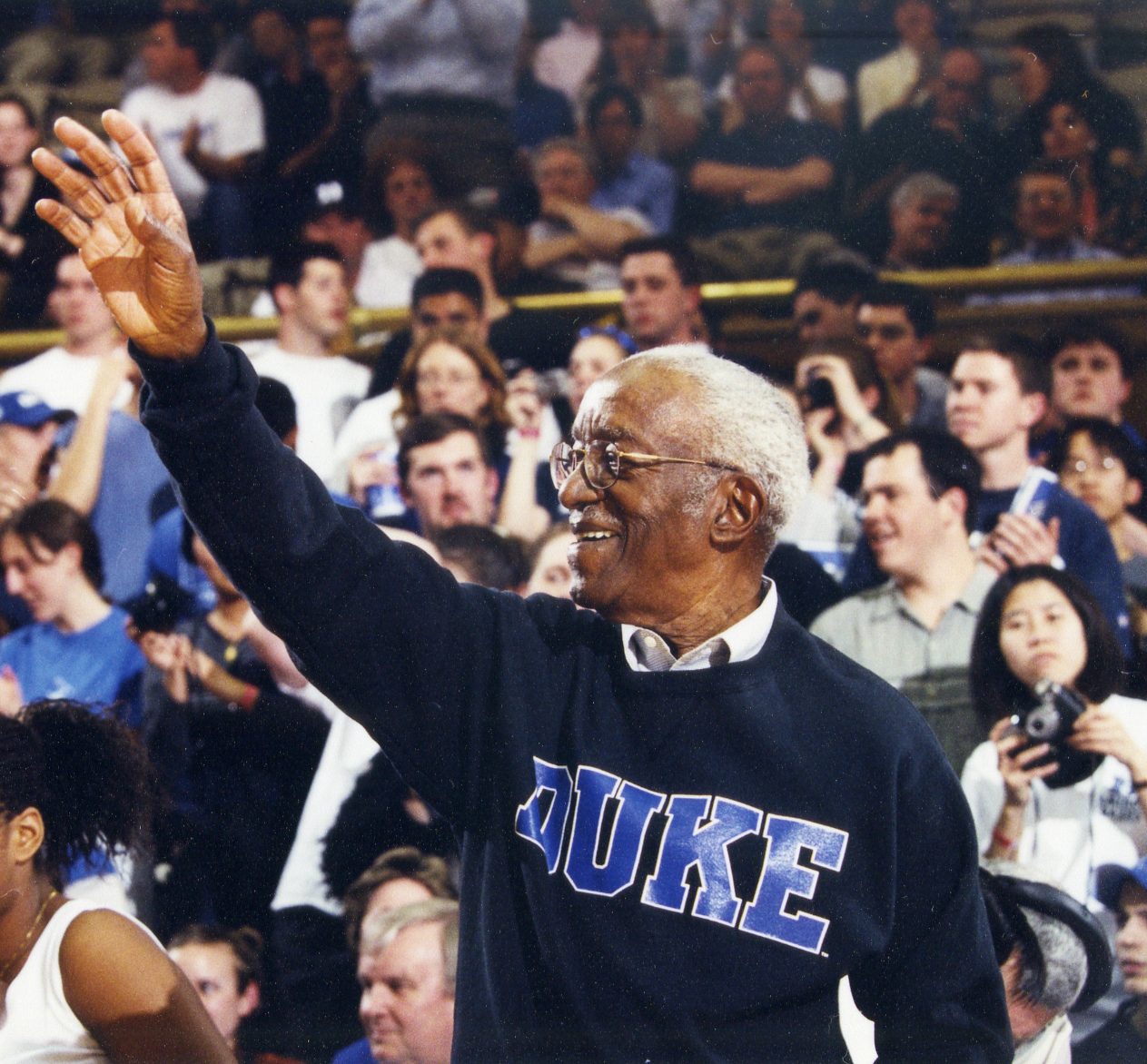 John Hope Franklin attends Duke University basketball game at Cameron Indoor Stadium, 2000
