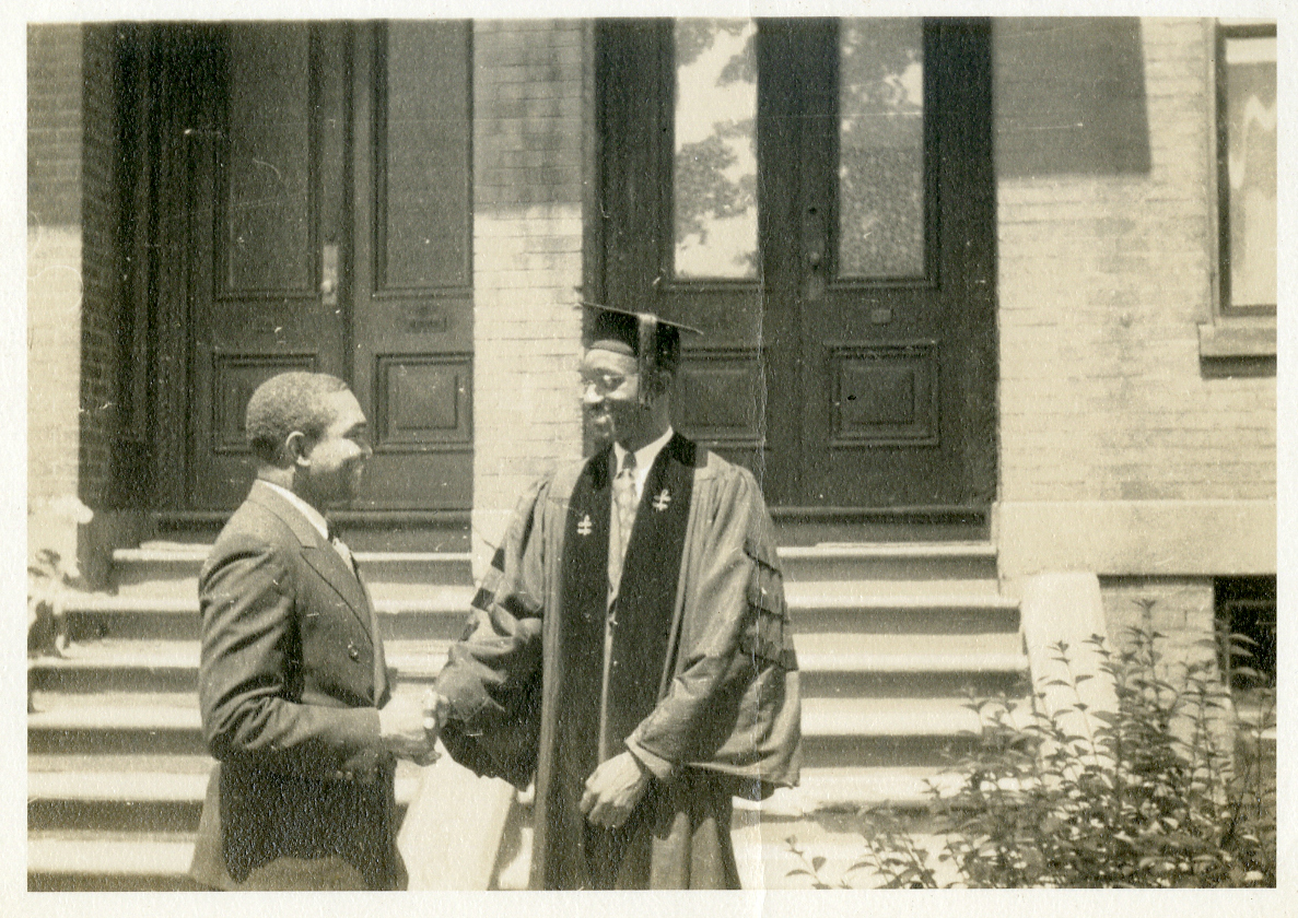John Hope Franklin and Emory Johnson the day he receives his PhD, 1941