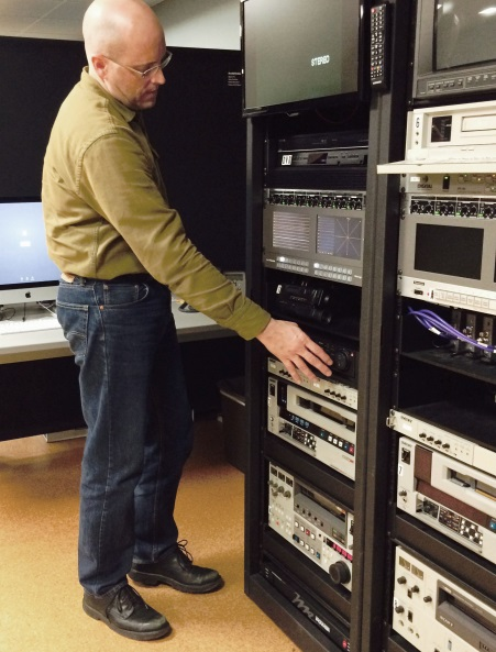 Alex Marsh operates the video deck bank. Tellingly, the digital conversion decks are made by the 'Blackmagic' company