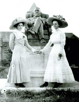 Two Women in front of the Washington Duke statue, ca. 1900s. From the University Archives Photograph Collection.