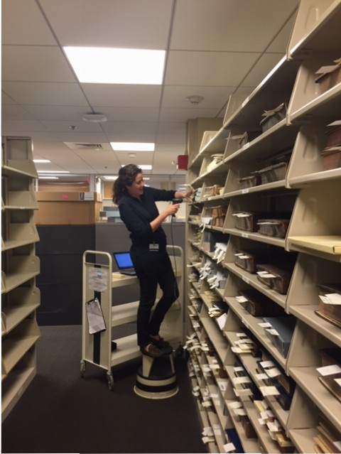 Cataloger Lauren Reno scans books from our History of Medicine Collections. Photo by Rachel Ingold.