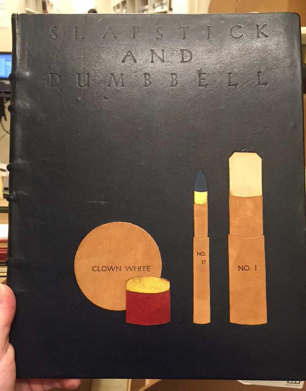 Inlaid leather cover on Slapstick and Dumbbell : a Casual Survey of Clowns and Clowning.